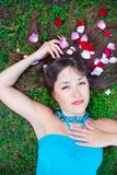 Girl is laying on the grass Stock Image