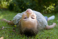 Girl laying on grass Royalty Free Stock Photo