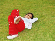 Girl Laying on Grass Royalty Free Stock Images