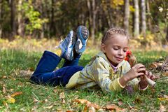 A girl is laying on a grass in the forest Stock Photos