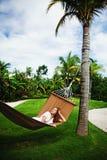 Girl laying in hammok Royalty Free Stock Photos