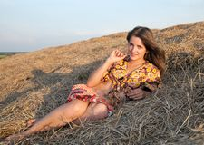 Girl laying in hay Royalty Free Stock Image