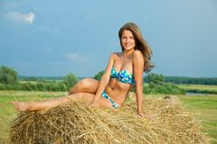 Girl laying  hay bail Royalty Free Stock Photography