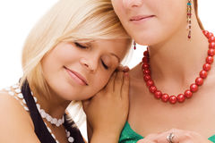 Girl laying her head on friend's shoulder Stock Photos