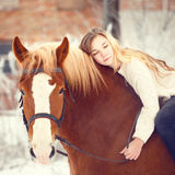 Girl laying on horse neck. Friendship background Stock Photos