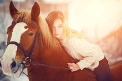 Girl laying on horse neck. Friendship background Stock Images