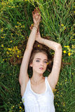 Girl laying in meadow Royalty Free Stock Photos