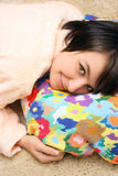 Girl laying on the pillow Royalty Free Stock Photography