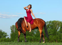 Girl laying relaxed bareback on her horse Stock Photo