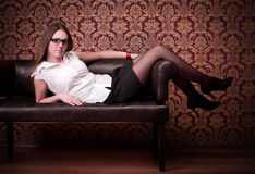 Girl laying on sofa Royalty Free Stock Images