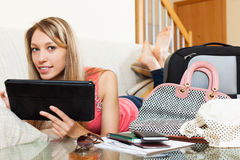 Girl laying on sofa near luggage Royalty Free Stock Photo