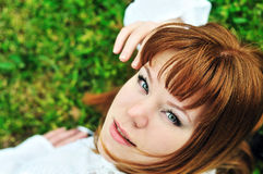 Girl laying on the spring meadow Stock Image