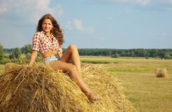 Girl laying on  of straw Stock Photo