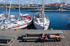 Girl laying in sun in Vrango, Sweden Stock Image