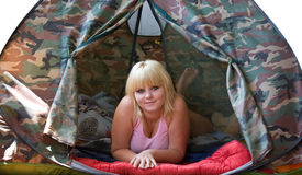 Girl laying in a tent. Young blonde  lying in tent Stock Photos