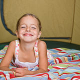 Girl laying in tent Stock Photos