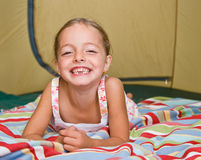 Girl laying in tent Stock Images