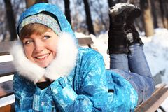 The girl lays on a bench. Winter entertainments Stock Photo