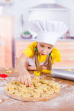 The girl lays on the Board from dough cookies Stock Photo