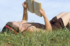 The girl lays on a grass Royalty Free Stock Photography