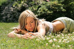 Girl lays in grass Royalty Free Stock Photos