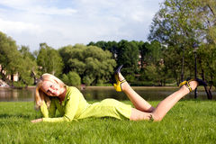 The girl lays on a grass Royalty Free Stock Image