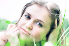 Girl lays on grass Royalty Free Stock Photos