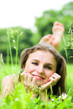Girl lays on grass Royalty Free Stock Photography