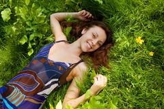 Girl lays on a grass a meadow. The girl lays on a grass a meadow stock photos