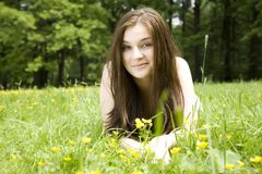 The Girl Lays On A Meadow Stock Photos