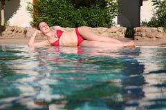 Girl lays at pool Royalty Free Stock Photos