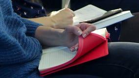 Girl lazily scrolls notebook stock video