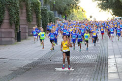 Girl in the lead followed by running competitors Royalty Free Stock Photo