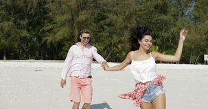 Girl Lead Man On Beach Holding Hand, Couple In Love Happy Smiling Tourists Summer Holiday. Slow Motion 60 stock video footage