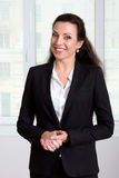 Girl leader in black business suit smiling Stock Image