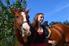 Girl leading horse Stock Photo