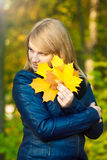 Girl with leaf Stock Photography