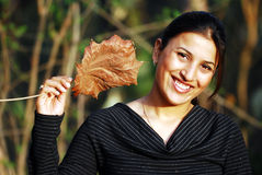 Girl with leaf. In wild Royalty Free Stock Photos