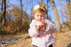 Girl with Leaf in Hand Royalty Free Stock Photography