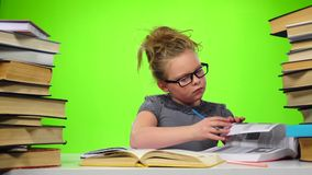 Girl leafing through the pages of books carefully. Green screen. Slow motion stock footage