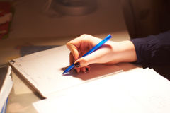 Girl writes on a paper sheet Royalty Free Stock Photo