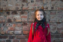 Girl close to brick wall Stock Photo