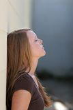 Girl leaning against wall royalty free stock photos