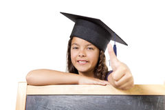 Girl leaning on blackboard Royalty Free Stock Photo