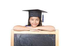 Girl leaning on blackboard Royalty Free Stock Image