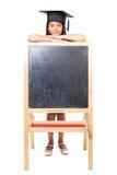 Girl leaning on blackboard Stock Photography