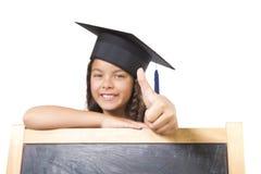 Girl leaning on blackboard Stock Images