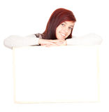 Girl leaning on a blank clipboard Stock Photography