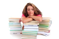 Girl leaning on book piles Royalty Free Stock Photo