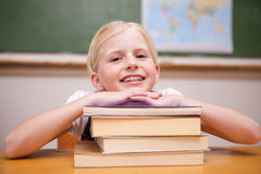 Girl leaning on books Royalty Free Stock Photo